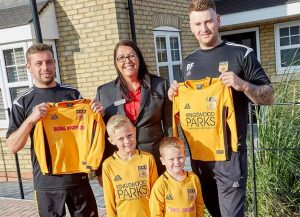 Pictured from left Kingswood United team coaches James McDonald and Ricky Foster with Beal Homes' sales executive from Kings Vale and young players Mason and Harry